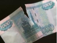 Дешевеющая нефть надавила на рубль