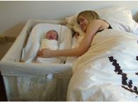 Производство детских колыбелей, прикрепляющихся к кровати родителей